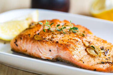 fresh garlic: Grilled Salmon with garlic and herb by lemon Stock Photo