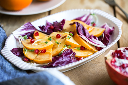 radicchio: Persimmon with Radicchio and Pomegranate salad by Balsamic dressing Stock Photo
