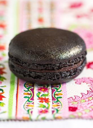 party pastries: Black Truffle Macaron on colourful napkin