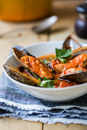 tomato sauce: Nezealand Mussels in Tomato and herbs sauce Stock Photo