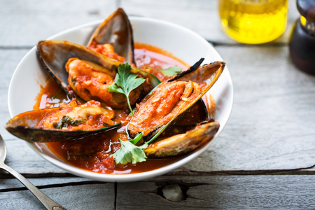 marinara: Nezealand Mussels in Tomato and herbs sauce Stock Photo
