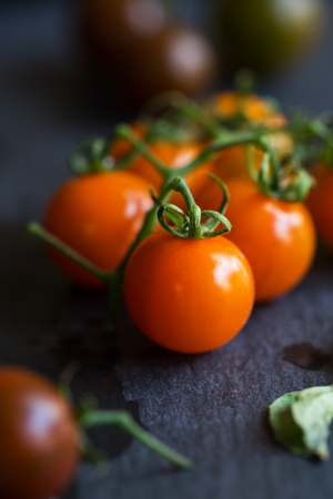 cherry varieties: Varieties color of Cherry Tomatoes on stone board Stock Photo