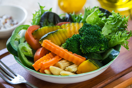 baby corn: Pumpkin,Broccoli with carrot and baby corn salad in a bowl Stock Photo
