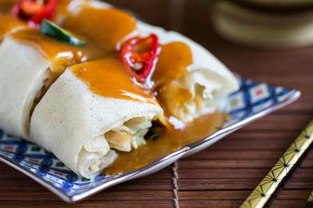 rice paper: Soft Spring rolls with gravy sauce by chopsticks