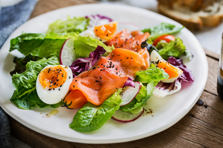smoked salmon: Smoked Salmon with boiled eggs salad by some bread Foto de archivo