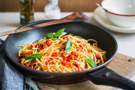 al fresco: Freshly cooked  Fettuccini with cherry tomatoes in a sauce pan