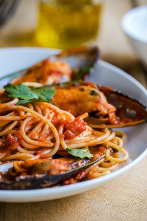 marinara sauce: Spaghetti with Mussel in tomato and herbs sauce