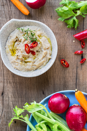 Cannellini beans dip with baby carrot,celery and radish Stock Photo