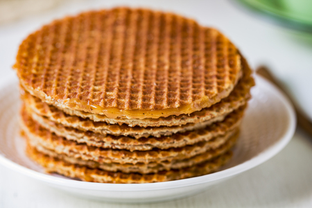 treacle: Pile of Stoopwafels by a cup of coffee Stock Photo