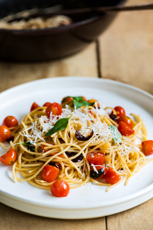 Spaghetti with Cherry tomatoes and dried chili with grated Parmesan Stock Photo