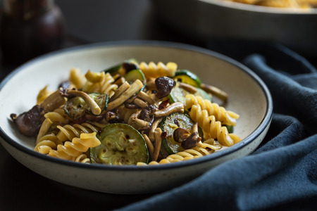 Fusilli with Mushroom, Garlic and Zucchini Stock Photo