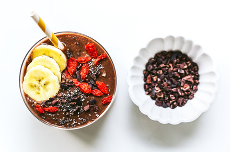 Banana,Coconut water, Chia seed and Cacao Smoothie with Goji and Cacao nib topping