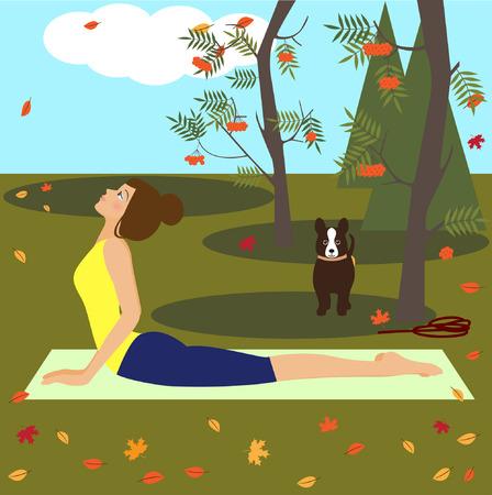 autumn park: yoga girl with dog in autumn park