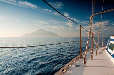 Sailing on yacht on beautiful clear sea