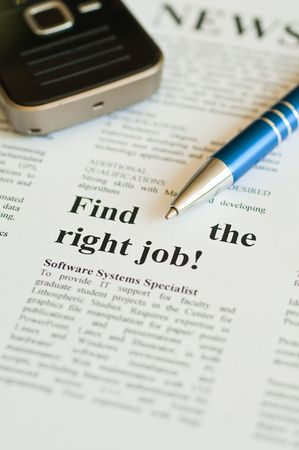 Finding a job with pen and newspaper 免版税图像