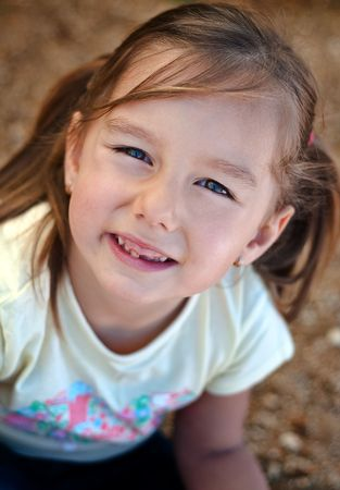 Smiling happy girl - close portrait