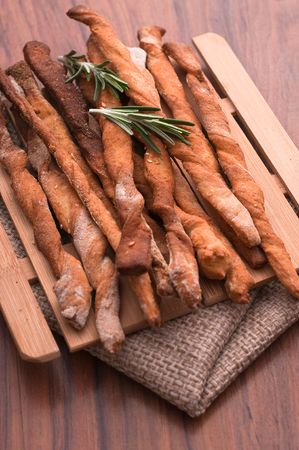 Homemade sticks with rosemary on a towel 免版税图像