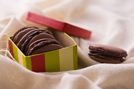 French macarons with dark chocolate photo