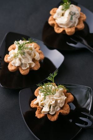 Cold tartalette with cheese cream and dill photo