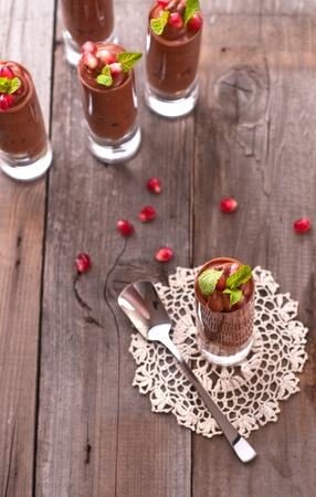 Chocolate mousse with pomegranate and mint photo