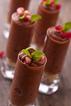 Chocolate mousse with pomegranate and mint Stock Photo