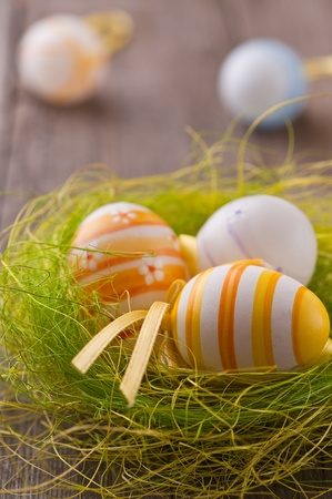 Colorful Easter eggs in green grass nest