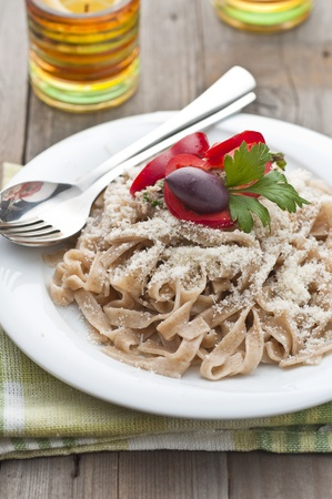 Homemade pasta, decorated with parsley and olive