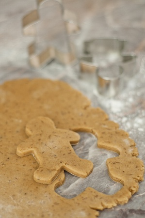 pastry cutter: Cut gingerbread man over working surface Stock Photo