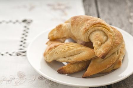 Fresh homemade croissants in white plate photo