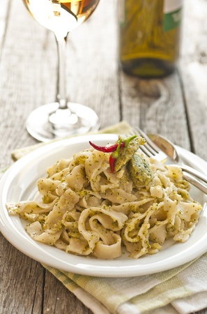 Homemade tagliatelle with glass of wine