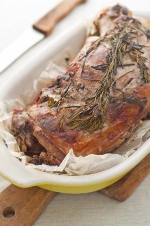 Roasted lamb leg on table