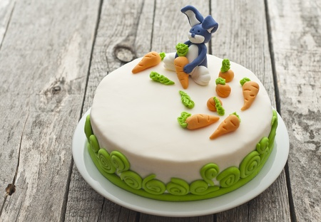 birthday cakes: Carrot cake with bunny decoration Stock Photo