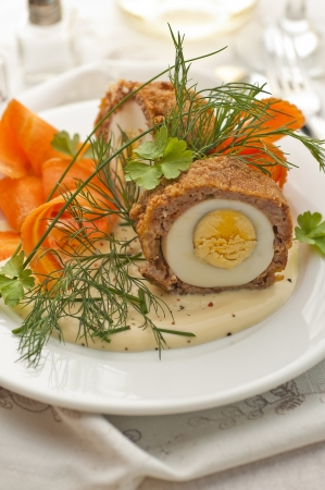 Meat and egg patties decorated with fresh herbs photo