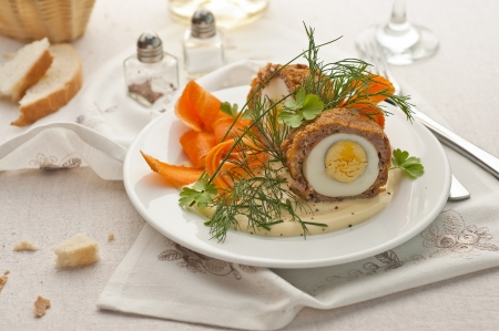 Meat and egg patties decorated with fresh herbs