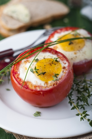 Red tomates stuffed with eggs and thyme Standard-Bild