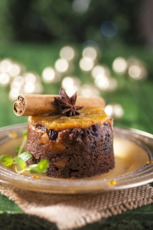 Christmas pudding with orange with festive lights