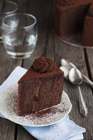 chocolate slice: late and cocoa cake on old wood table