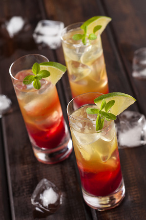 shots: Raspberries lemonchello shots with ice and lime Stock Photo