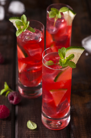 Raspberries shots with ice and lime Stock Photo
