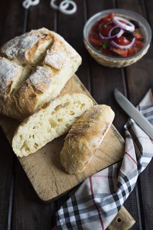 knead: No knead homemade bread on dark wood table Stock Photo