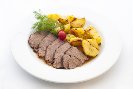 recipe decorated: Pork and potatoes dish isolated on white background