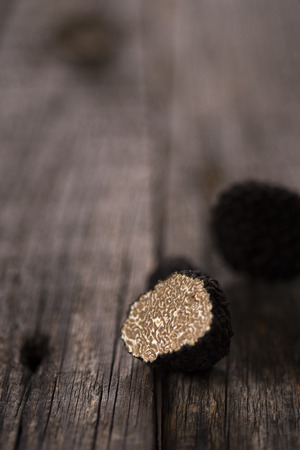 Natural black truffle on old wood table