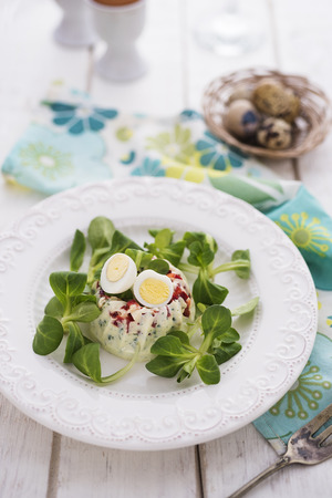 the greens: Egg nest appetizer with greens Stock Photo