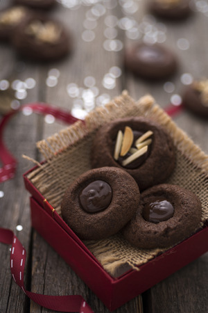 gift ribbon: Festive chocolate cookies with almonds Stock Photo