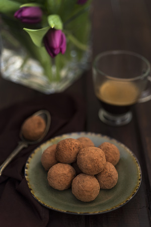 Raw cocoa truffles with a cup of coffee