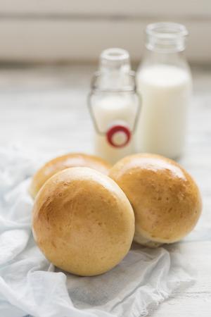 Milk rolls on white table Stock Photo