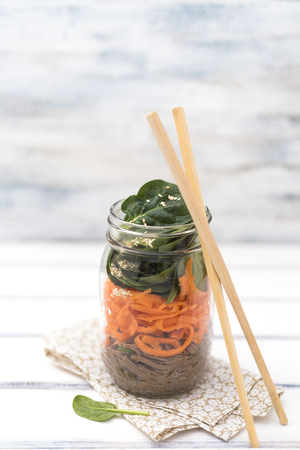 Soba, sesame and carrot salad in a jar