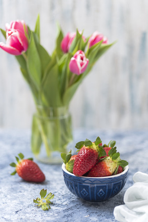 Strawberries and tulips still life