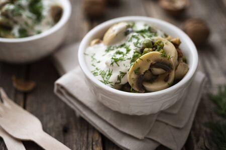 Marinated mushrooms with walnuts and tahini yogurt