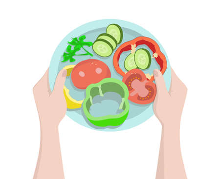 Plate with sliced fresh vegetables in the hands